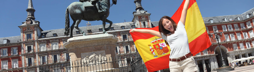 Woman holding a Spanish flag