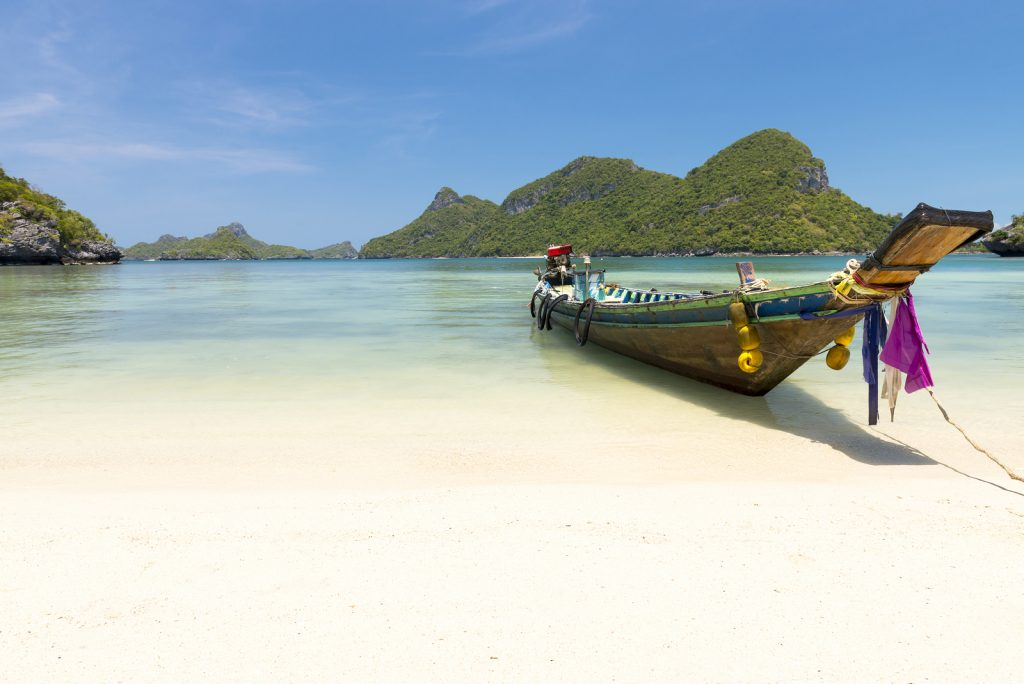 A boat docked on a Thai beach