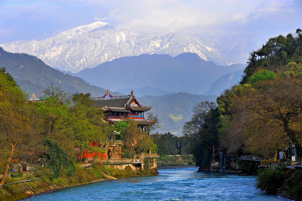 A river in china, mountain range in the backdrop