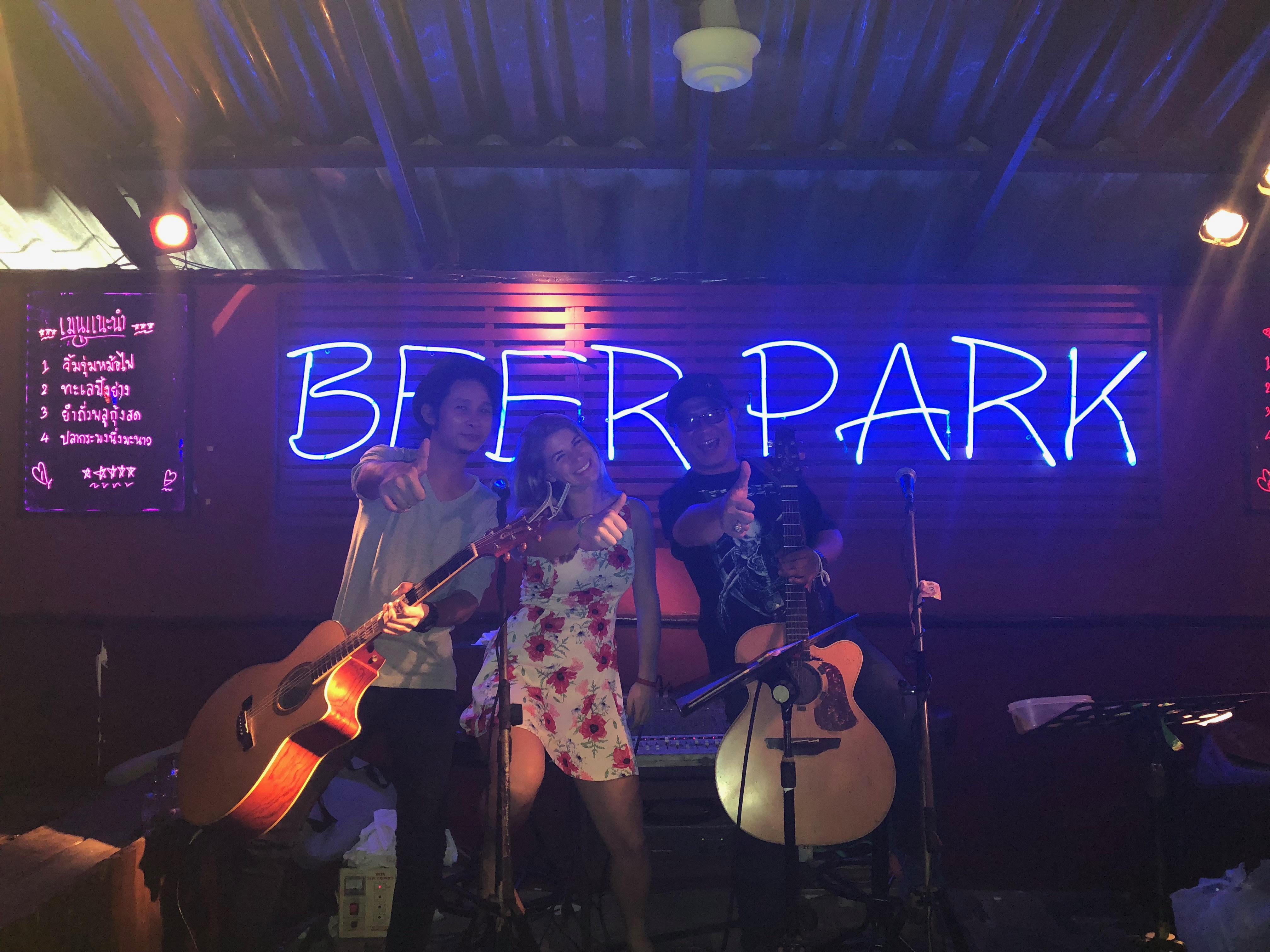 Alyssa singing at a bar