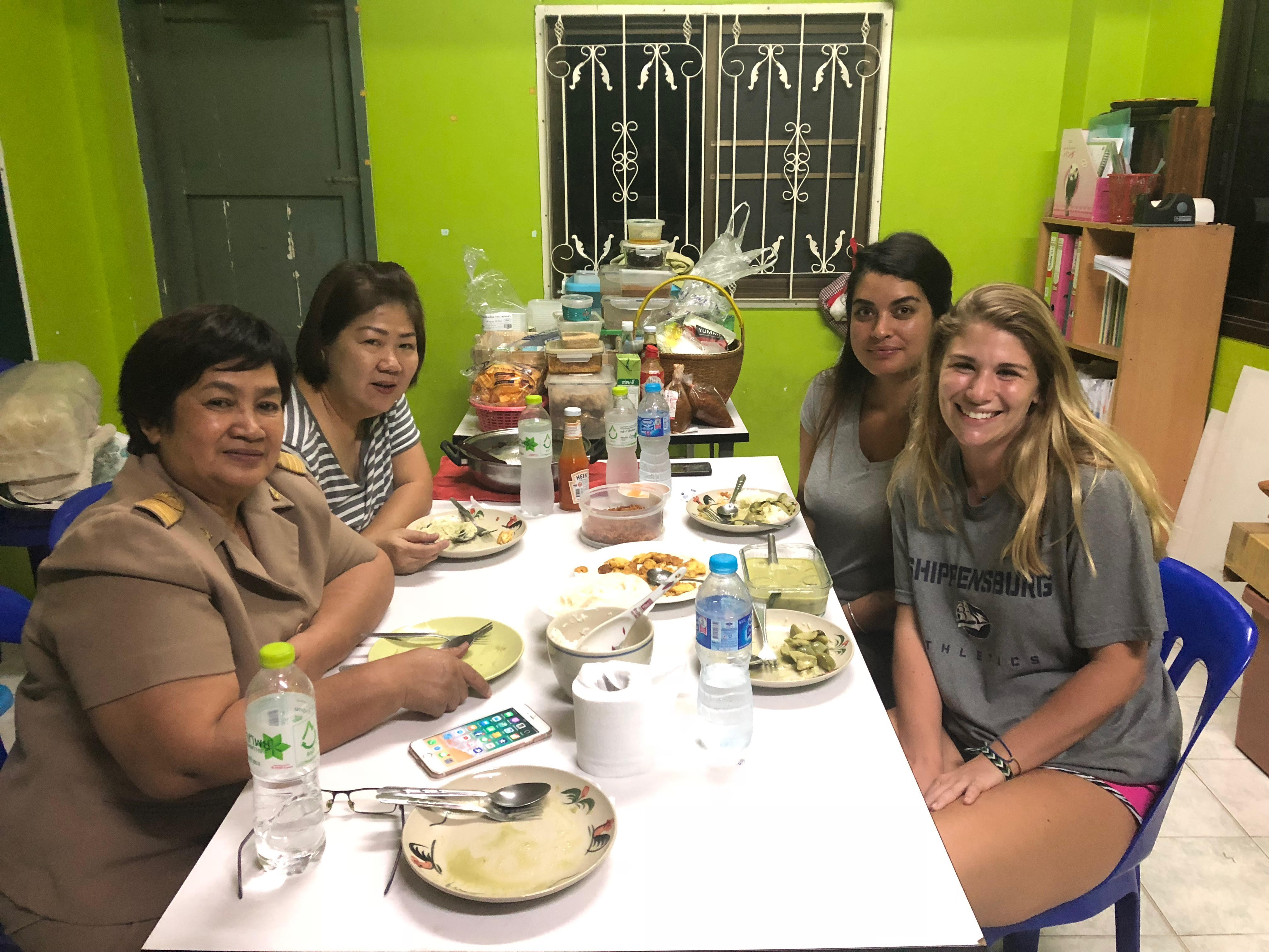 Alyssa having a meal with her host family