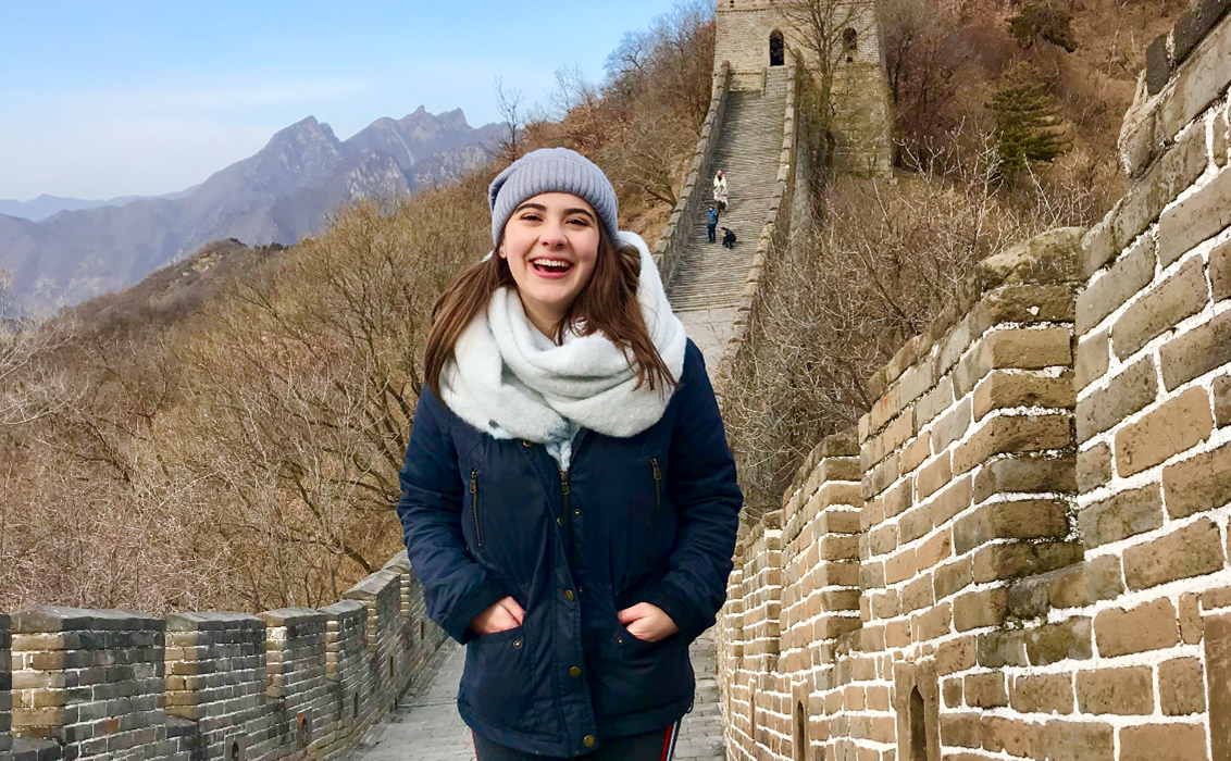 Samantha walking along the Great Wall of China