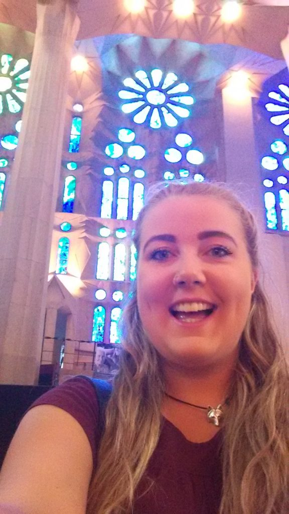 Nikki taking a selfie in a church