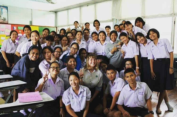 Beth taking a picture with her students