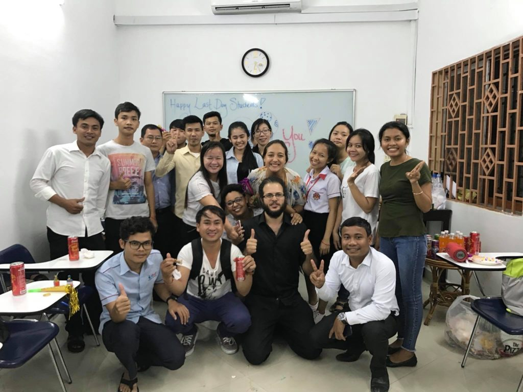 Eva taking a picture with her students