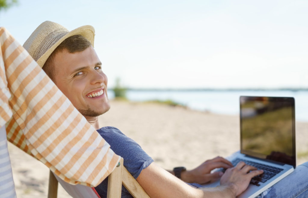 laptop at the beach 1024x659 - Teach English Online: 5 Awesome Companies to Choose From