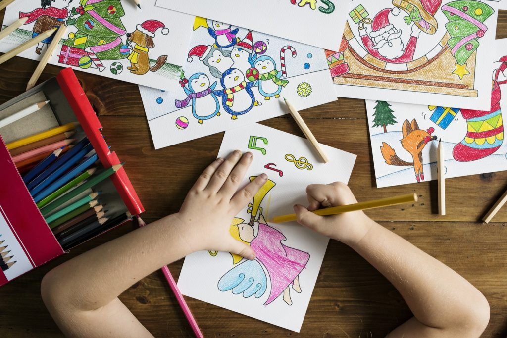 Child drawing and coloring