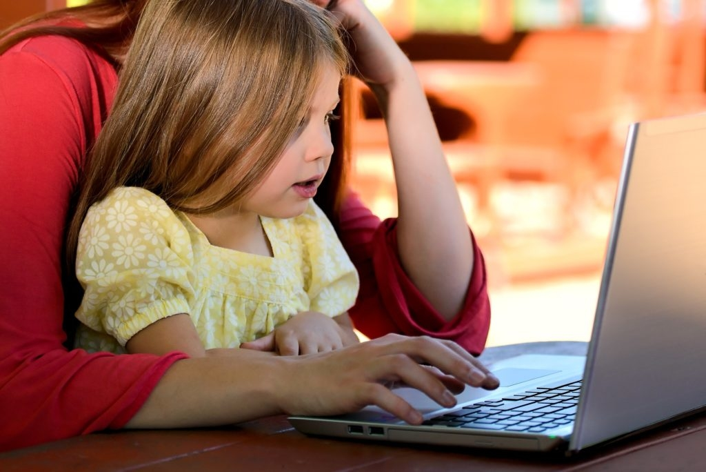 Child looking at a laptop.