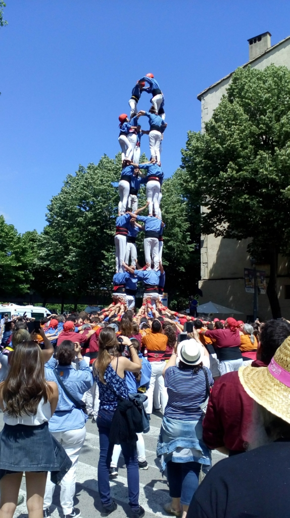 The locals making a human pyramid.