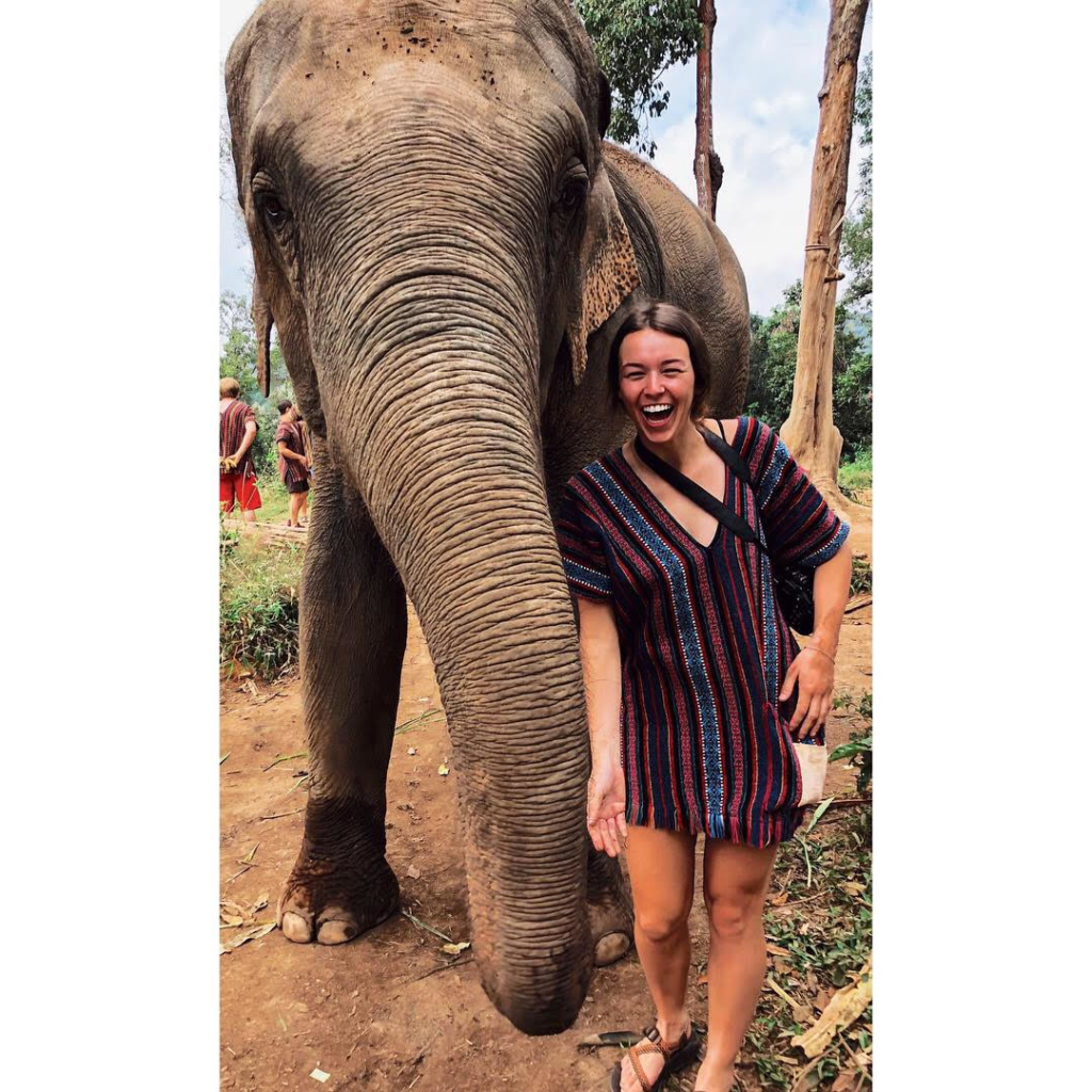 Brittany taking a picture with an elephant.