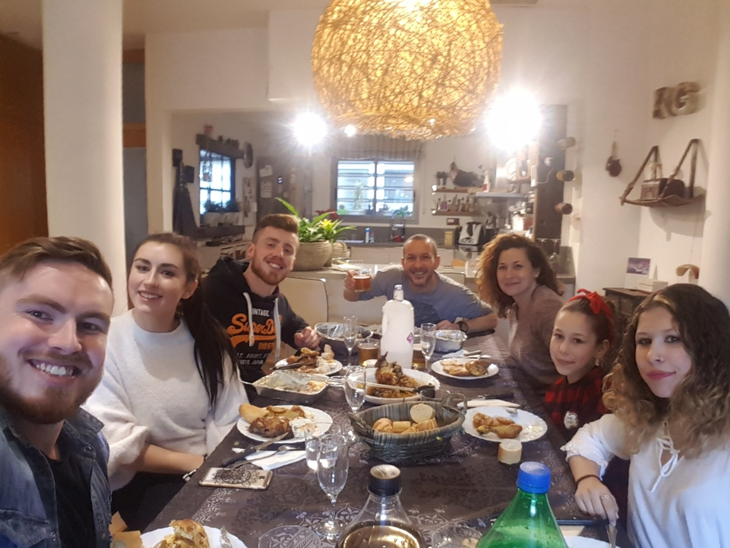 Jamie having a meal with his host family