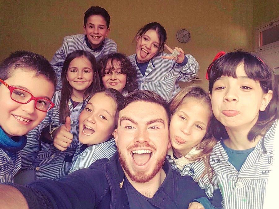 Jamie taking a selfie with his students.