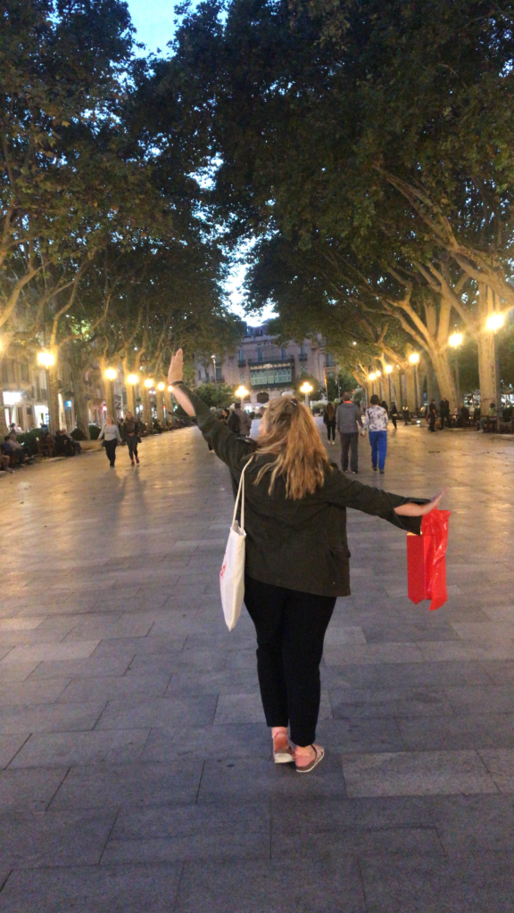 Tilly walking though Barcelona at night.