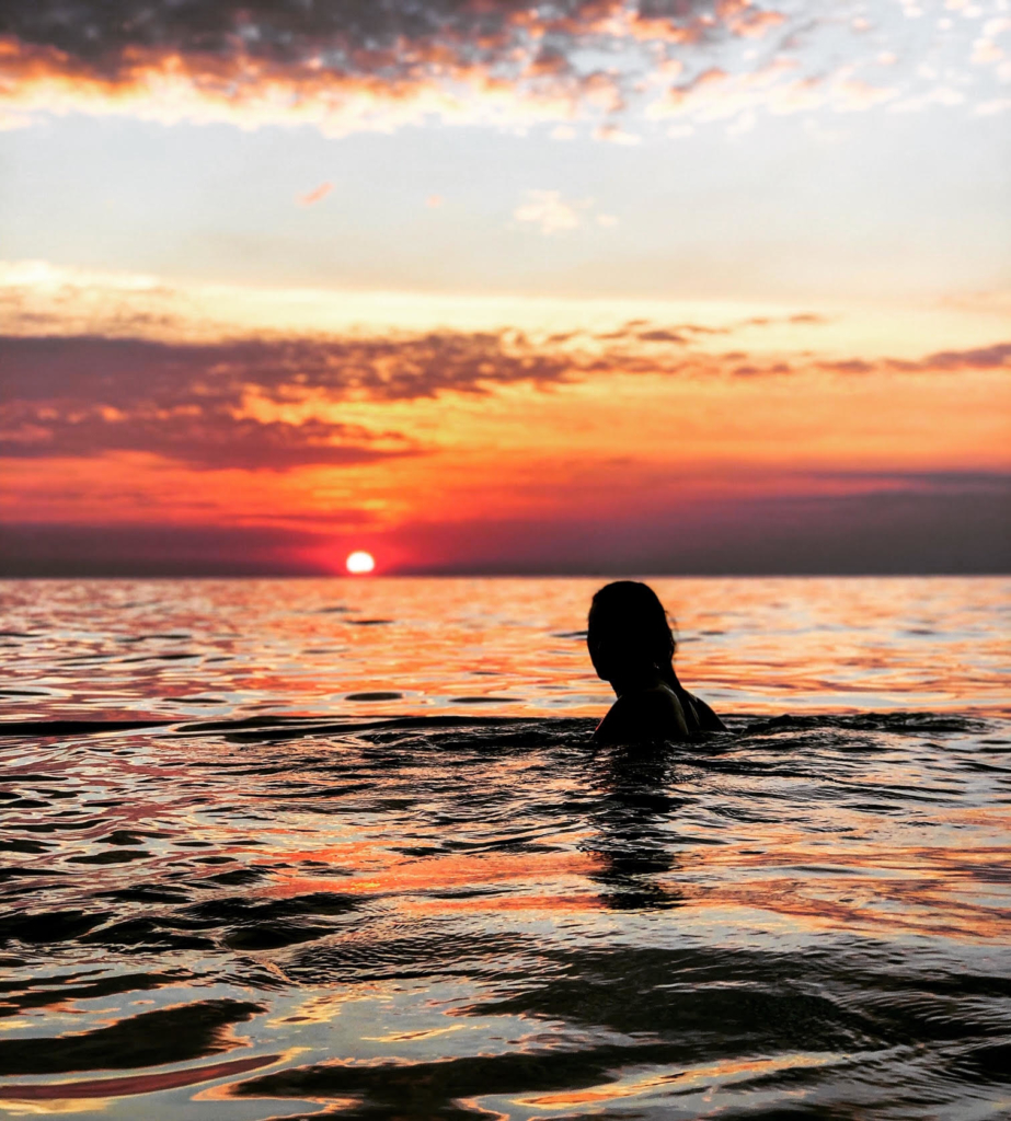 Brittany having a swim as the sunsets.