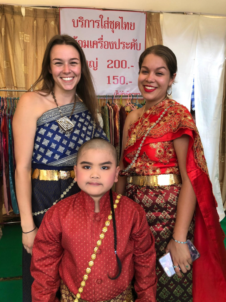 Brittany trying on traditional Thai clothing.