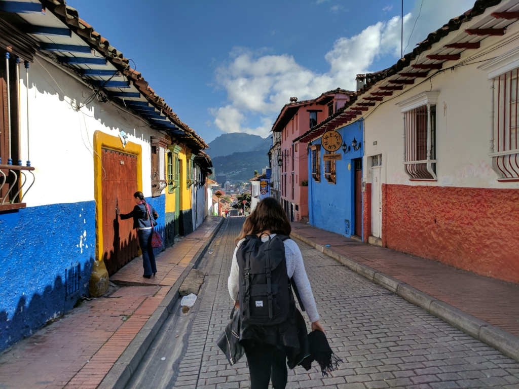 A traveler walking down a street in Columbia