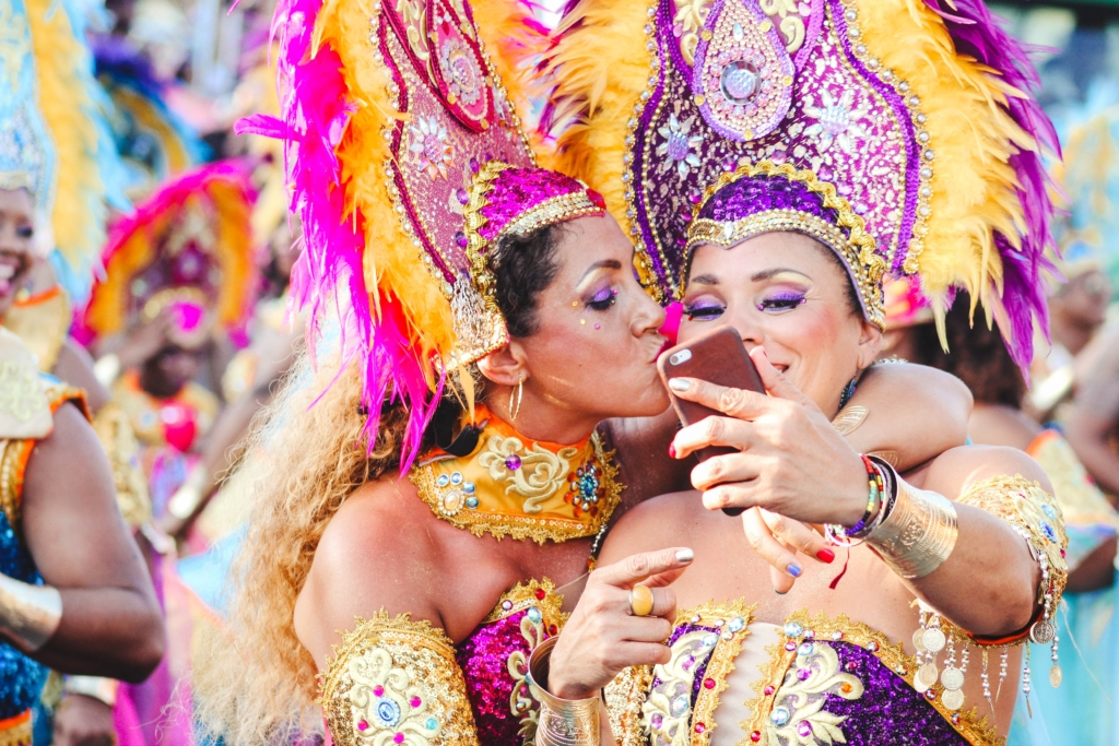 Two women taking a selfie all dressed up in festival attire.