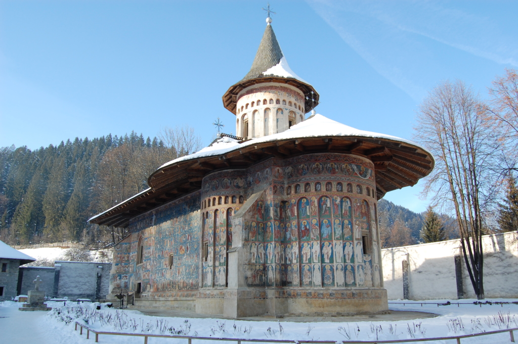 Romanian historical church covered in a sheet of snow.