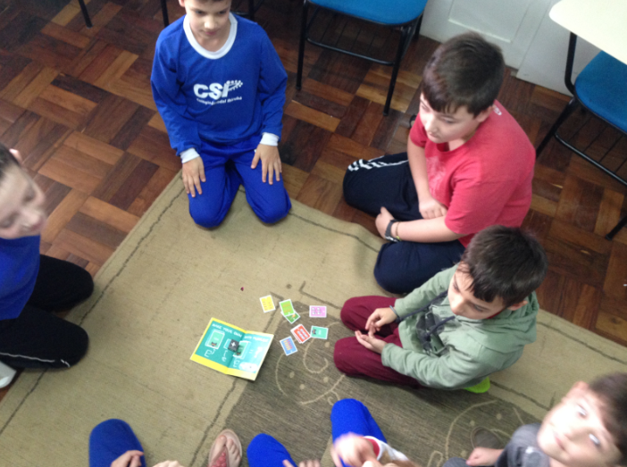 Children playing a card game.