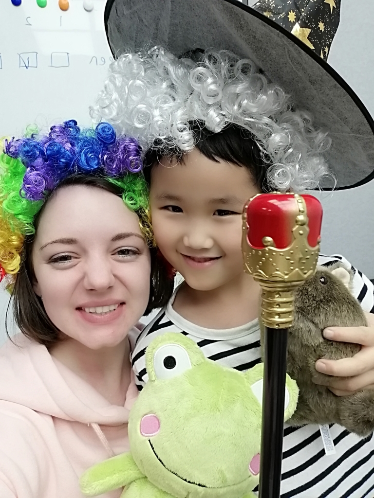 Briana Liu taking a selfie with her student.