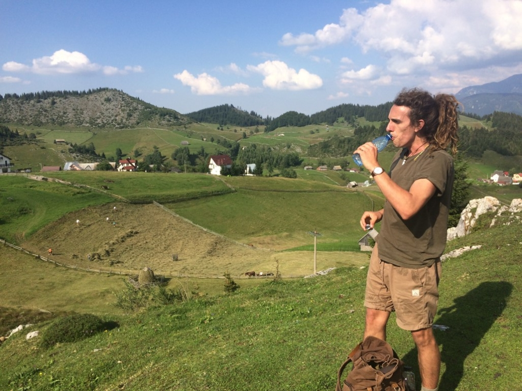 Marcus walking through the Romanian countryside.