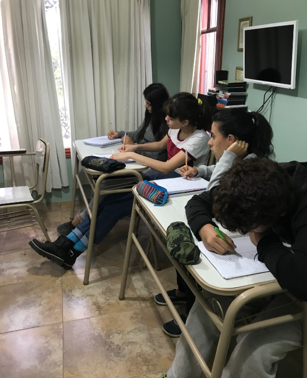Argentinian students taking notes in class.