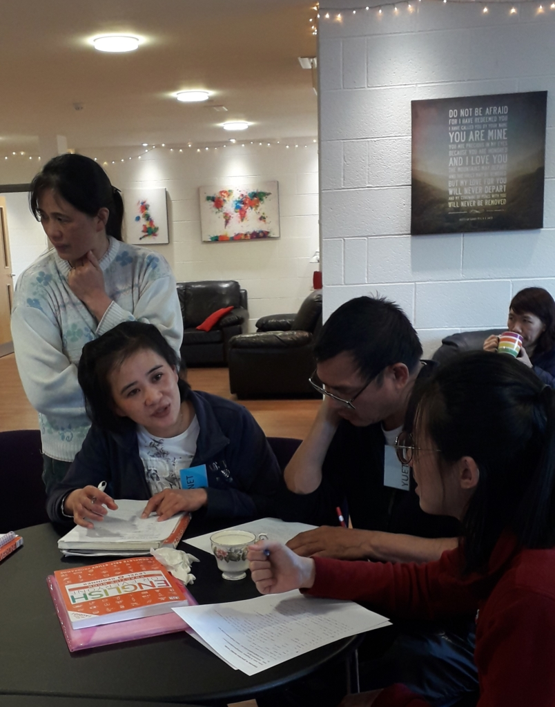 Chinese students discussing their work.