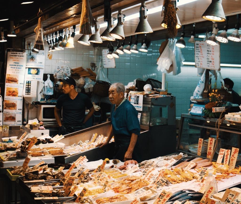 Man Selling Fish At A Market