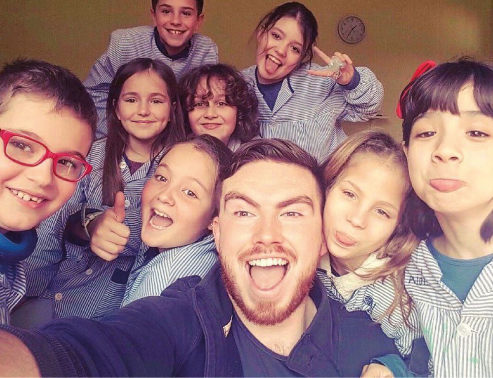 Teacher with his students