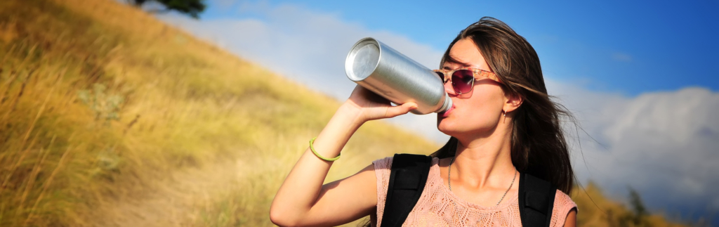 Woman drinking water hero 1024x323 - TEFL Packing Tips for Traveling Abroad