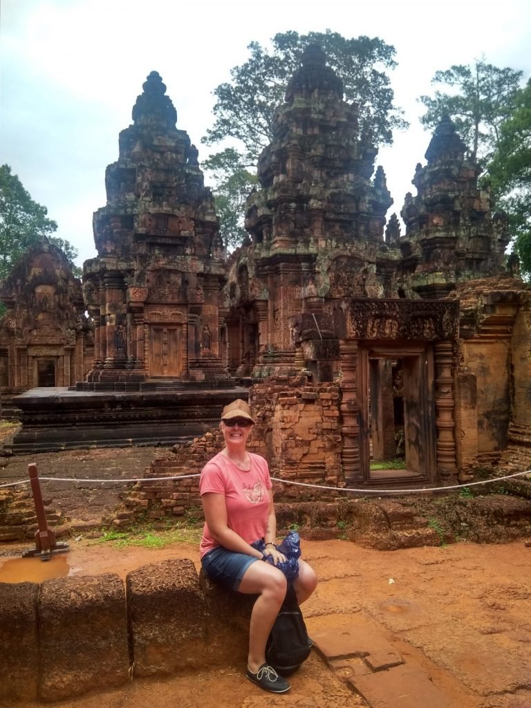Tanya posing outside a temple in Cambodia