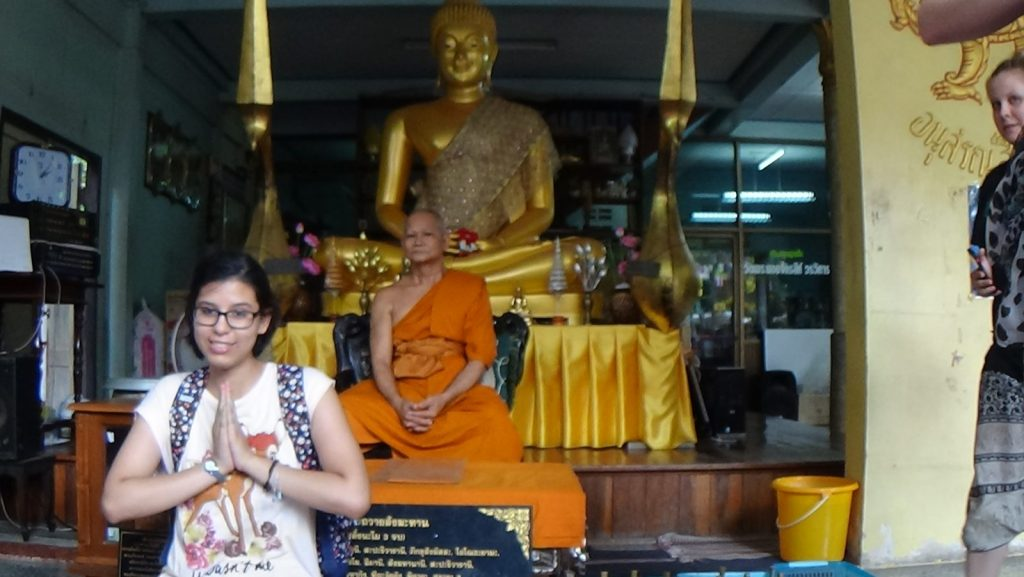 Andrea posing with a monk