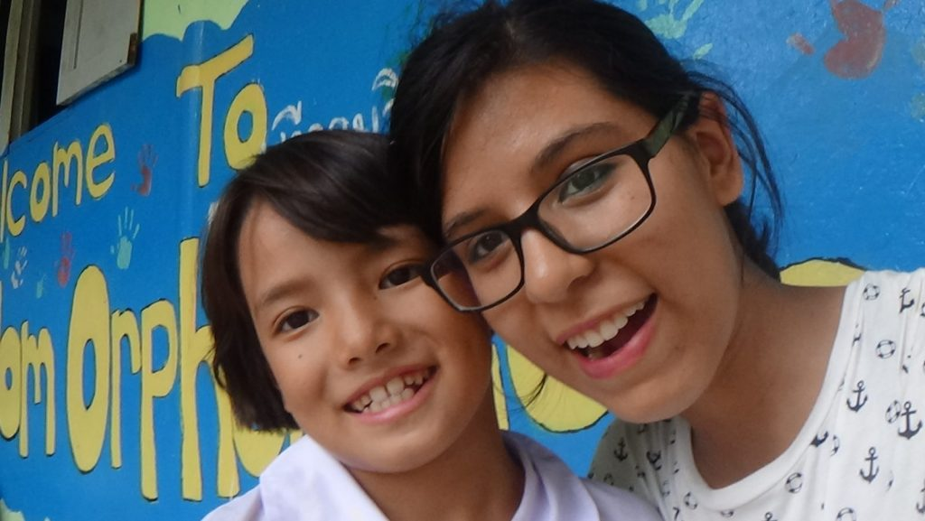 Andrea with her student