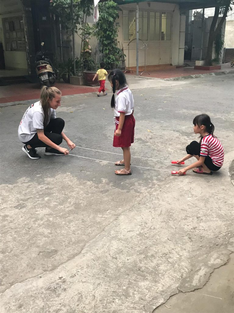 Teacher and student playing in Vietnam