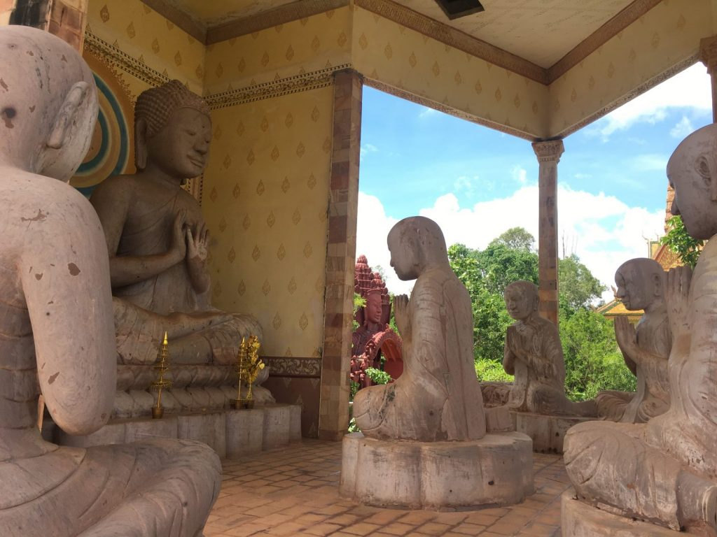 Buddhist statues inside a temple 1024x768 - Meet Katherine Garcia - A Texan in Cambodia
