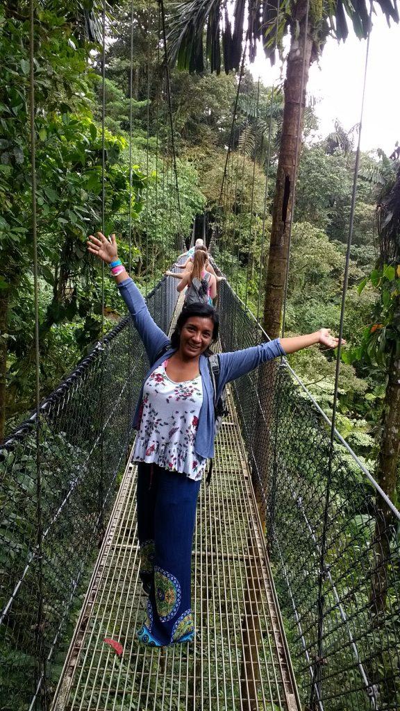 Lorena posing on a bridge