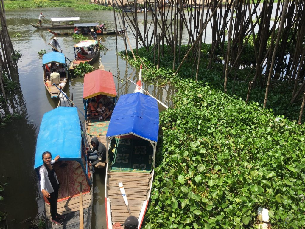 People preparing for a boat trip in Cambodia