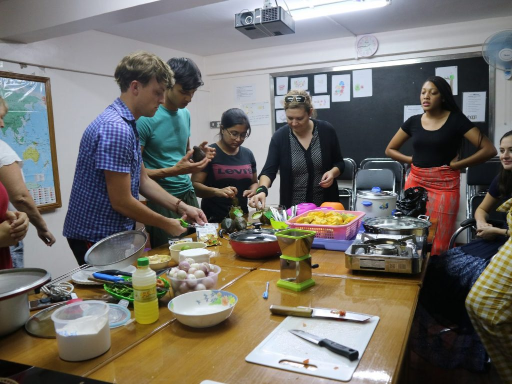 Teachers preparing a meal