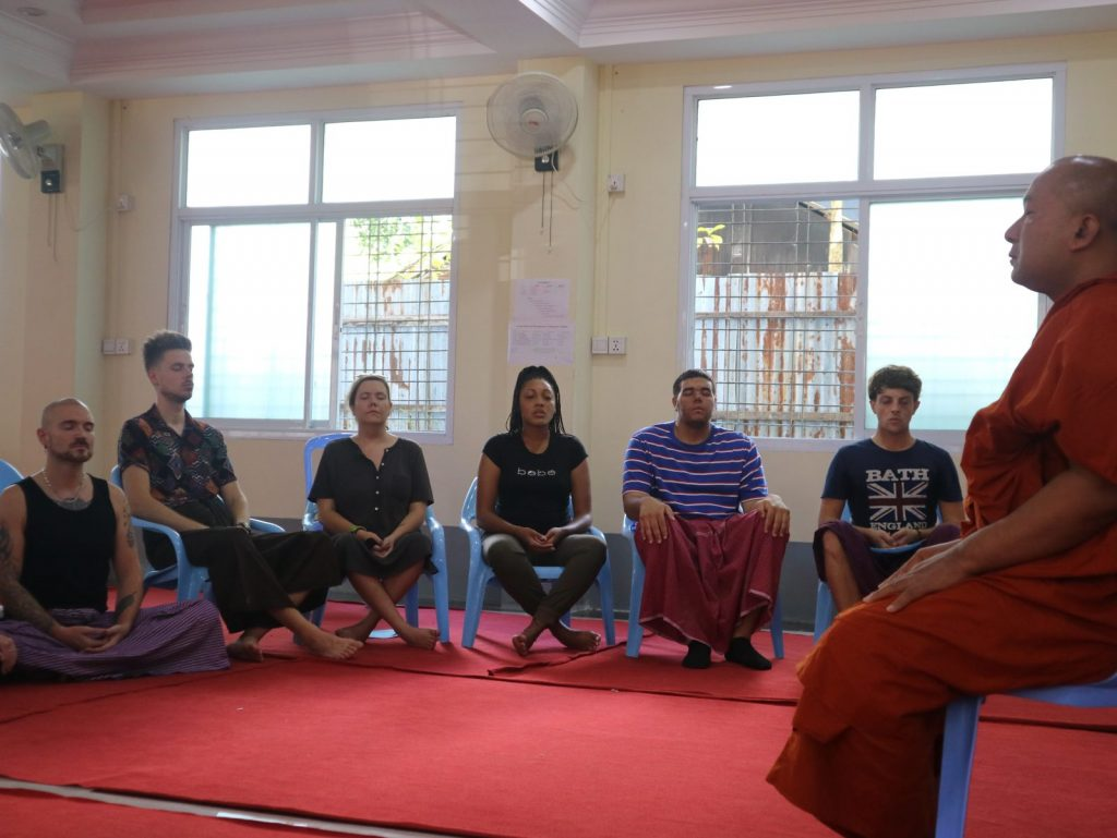 TEFL teachers meditating with a monk in Myanmar