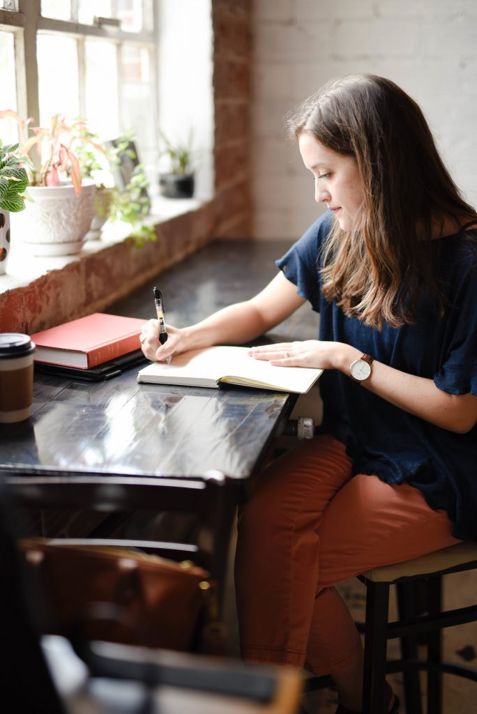 Woman planning in a journal