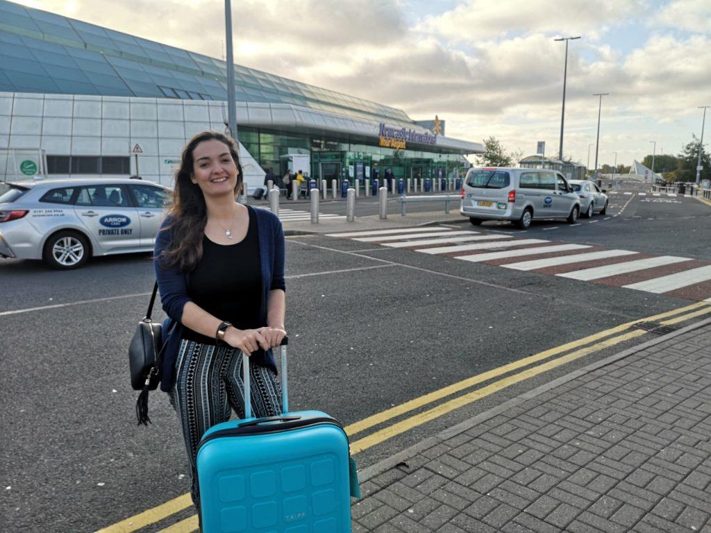 Taryn outside an airport with her luggage 1024x768 - English teaching in Thailand - Meet Taryn Beasley