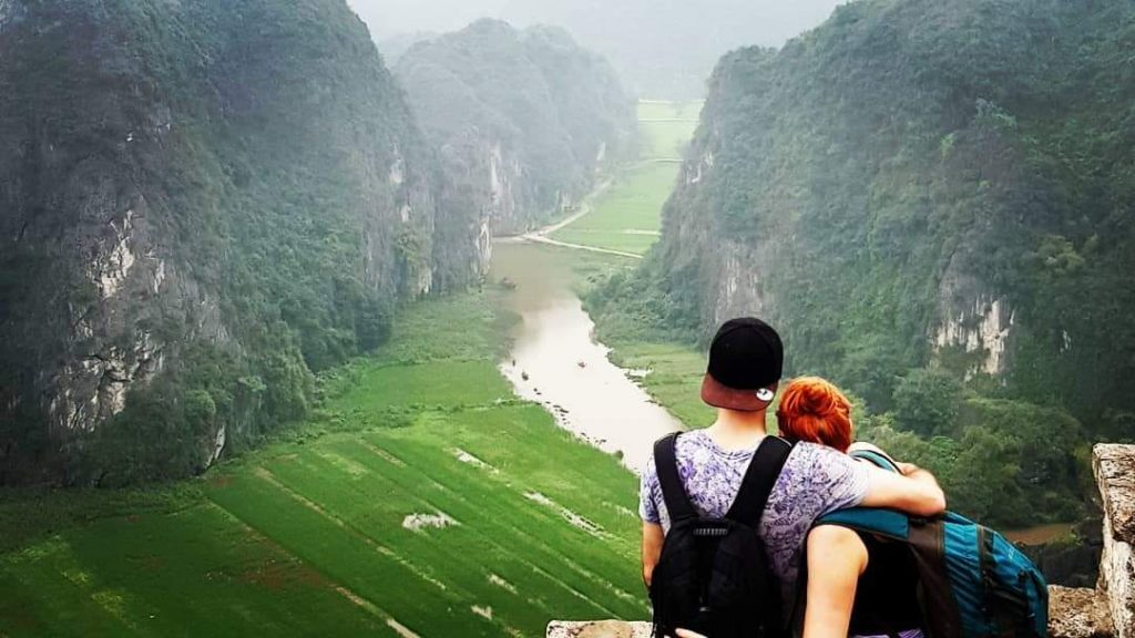 Couple looking over a valley in Vietnam