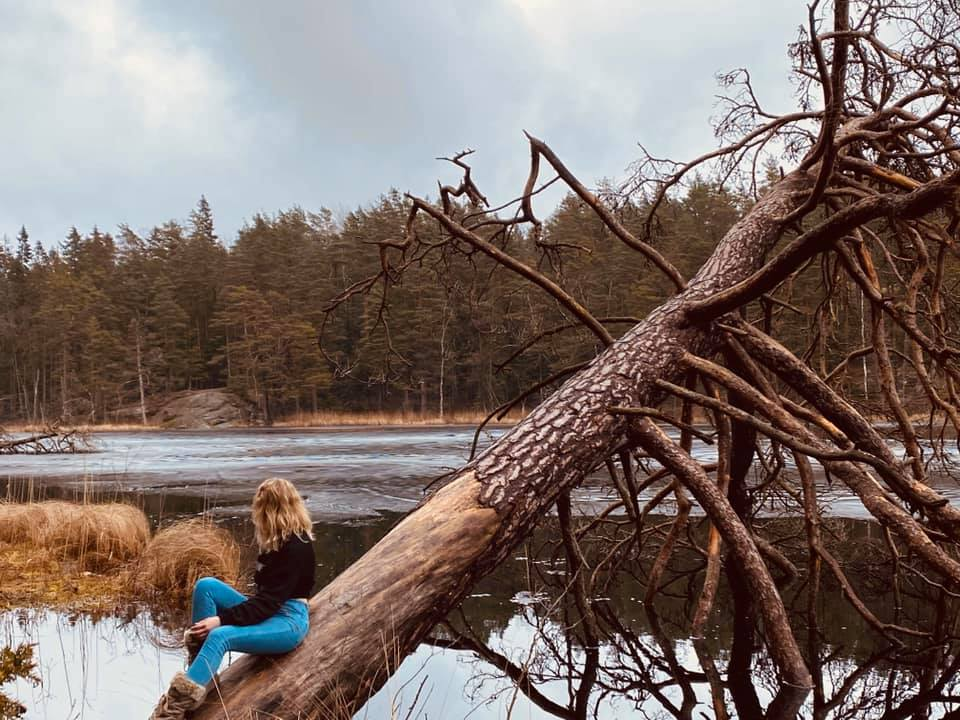 Anastasia relaxing at a lake