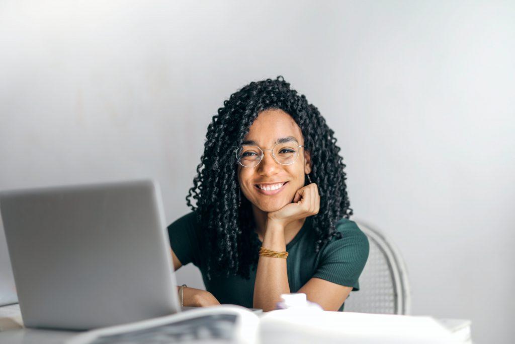 Women teaching at laptop at desk
