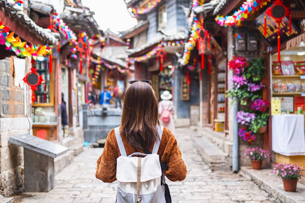 Woman walking through market South Korea