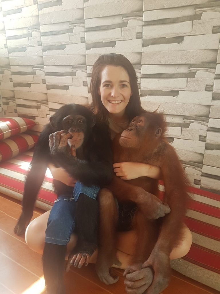 Woman with two monkeys